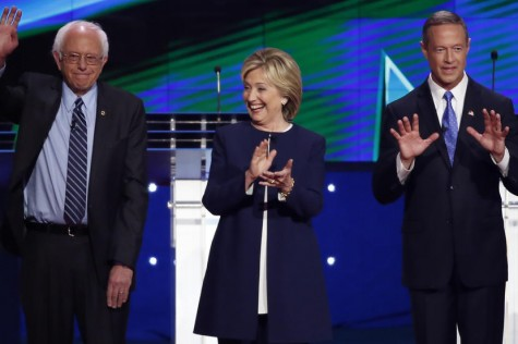 Democratic presidential candidates U.S. Senator Bernie Sanders (L), former Secretary of State Hillary Clinton (C) and former Maryland Governor Martin O'Malley react to the crowd before the start of the first official Democratic candidates debate of the 2016 presidential campaign in Las Vegas, Nevada October 13, 2015. REUTERS/Lucy Nicholson - RTS4CI6
