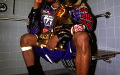 Kobe Bryant sits with the NBA Championship trophy after defeating the Philadelphia 76ers to win the 2001 NBA title on June 15, 2001 in Philadelphia, Pennsylvania. NOTE TO