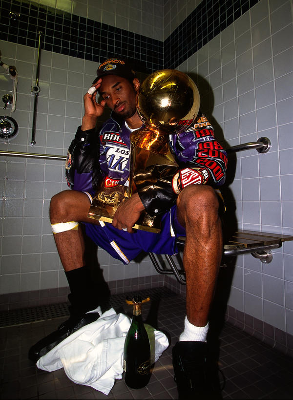 Kobe+Bryant+sits+with+the+NBA+Championship+trophy+after+defeating+the+Philadelphia+76ers+to+win+the+2001+NBA+title+on+June+15%2C+2001+in+Philadelphia%2C+Pennsylvania.+NOTE+TO