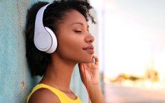 Portrait of a beautiful girl listening music