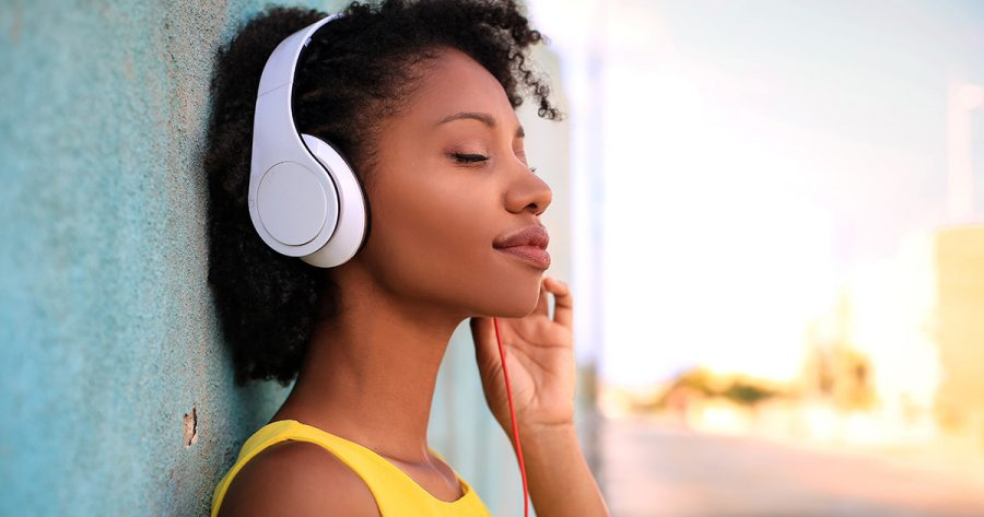 Portrait of a beautiful girl listening music